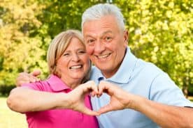 Parents over 70 smiling with an affordable life coverage