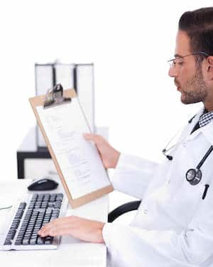 Busy doctor working with MIB reports